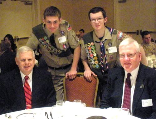 Eagle Scouts Trevor Perry (standing left) and Allen Ellis, at the 2013 Eagle Recognition Dinner with John Kuconis (left), Troop 16 Eagle mentor, and Steve Burrill of the Yankee Clipper Council.